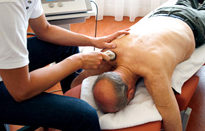 senior citizen receiving chronic pain management therapy