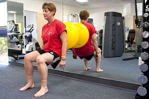 woman receiving post surgical rehab, strength training